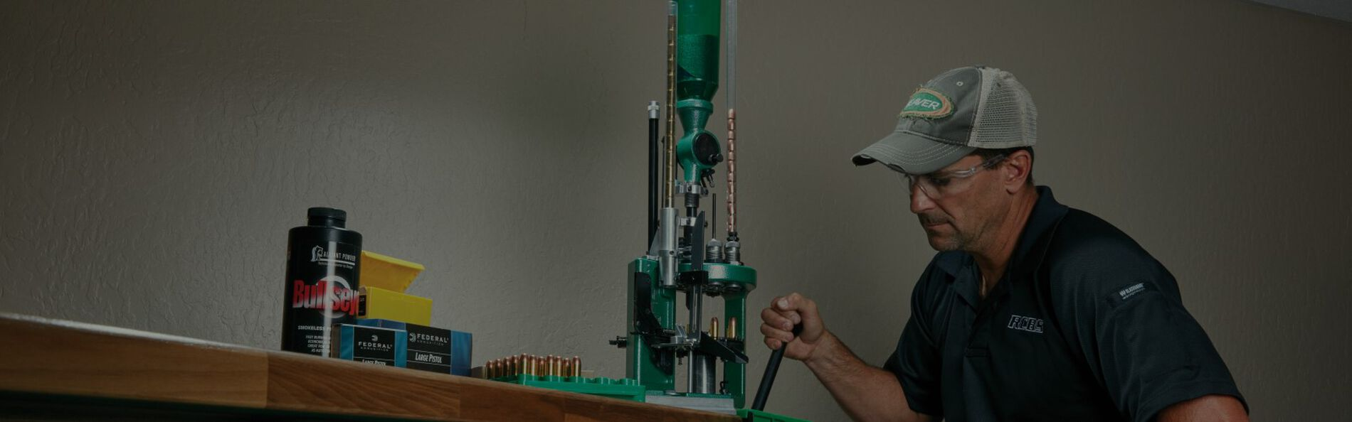man sitting at a reloading workbench