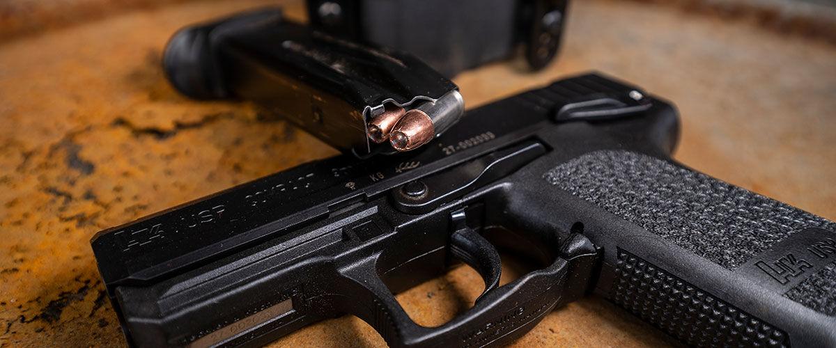 Handun with loaded magazine at range