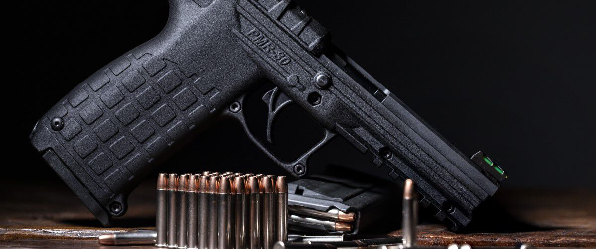 22 WMR cartridges in front of a handgun