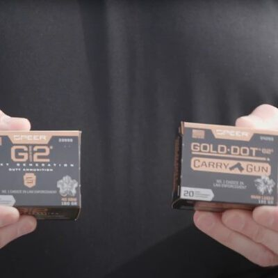 Patrick Kelley holding G2 and Carry Gun Packages