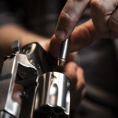 Handgun being loaded with ammo