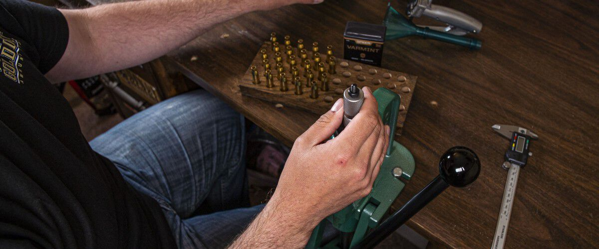 Man loading bullet cartridges