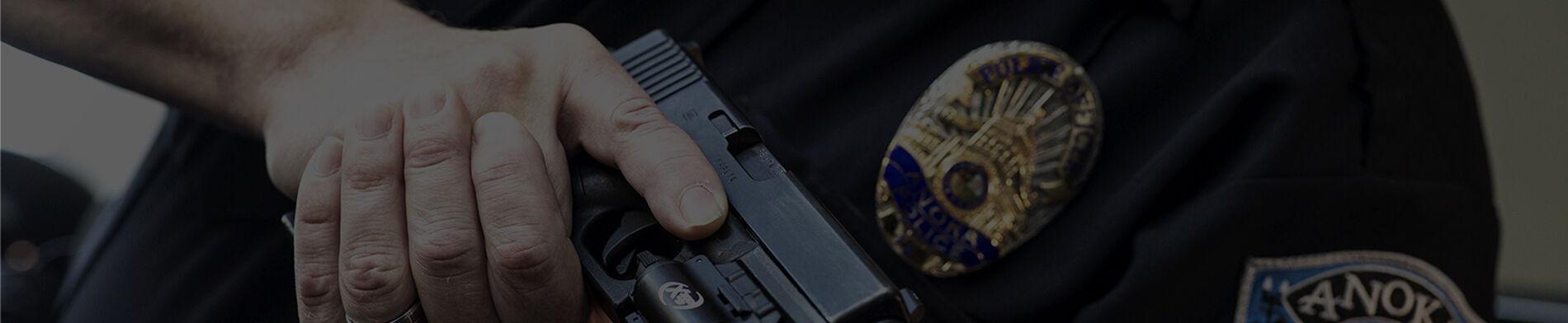 police holding a handgun