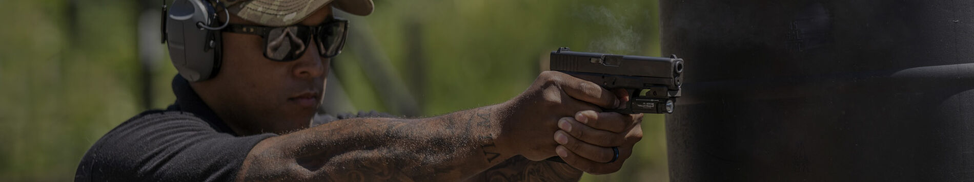 man pointing pistol outside