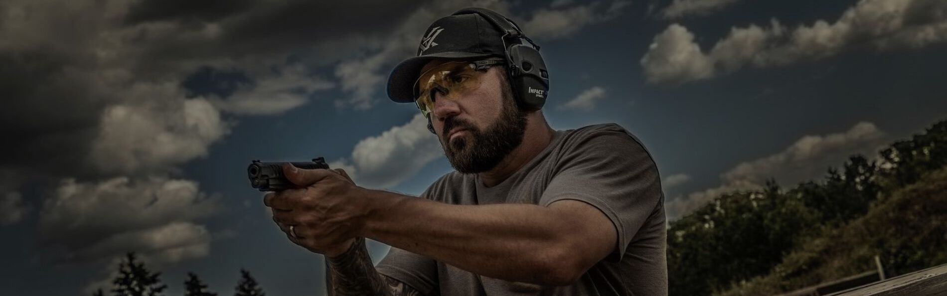 josh froelich shooting a handgun outside