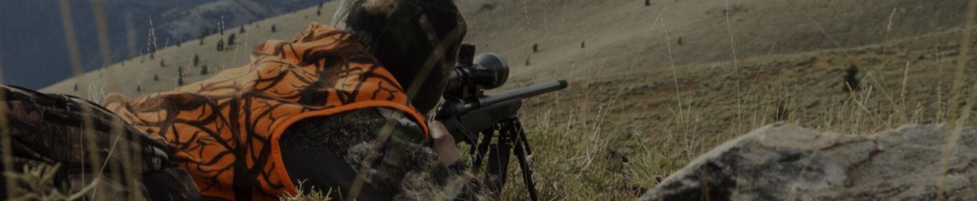 Hunter Shooting a Rifle